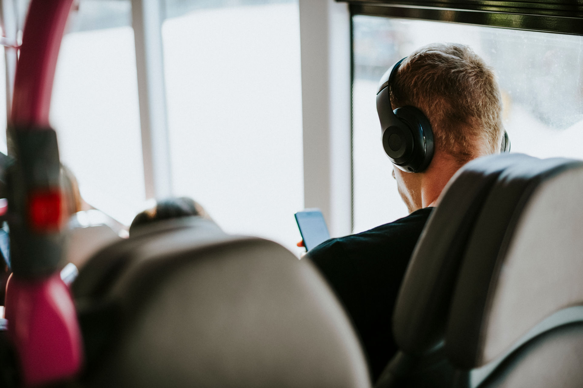 Man listening to a music on a bus